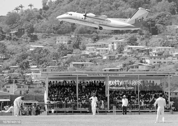 Low-flying LIAT Caribbean aircraft over the ground during day one of the tour match between West Indies Under-23s and Australians at the Arnos Vale...