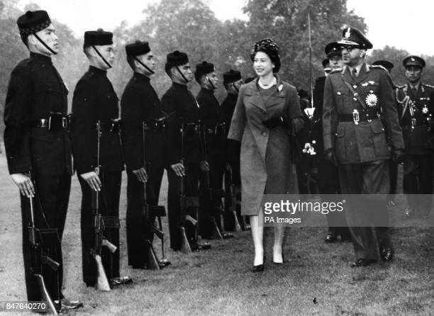 **Lowres scanned off print** Queen Elizabeth II and King Mahendra of Nepal inspect a contingent of the Brigade of Gurkhas during a review in the...