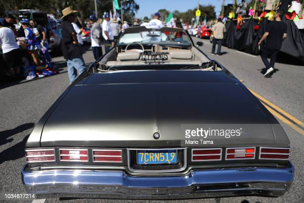 A 'lowrider' car is parked before the 72nd annual East LA Mexican Independence Day Parade on September 16 2018 in Los Angeles California 116 million...