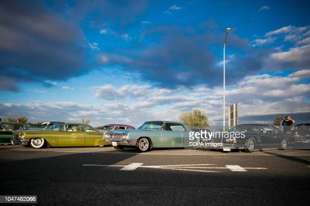 Lowrider cars seen parked on the Agui highway in Japan They are customized vehicles belonging to one of Japan's oldest lowrider clubs Pharaohs