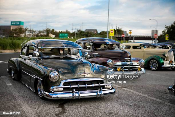 Lowrider cars seen parked on the Agui highway service station in Japan They are customized vehicles belonging to one of Japan's oldest lowrider clubs...