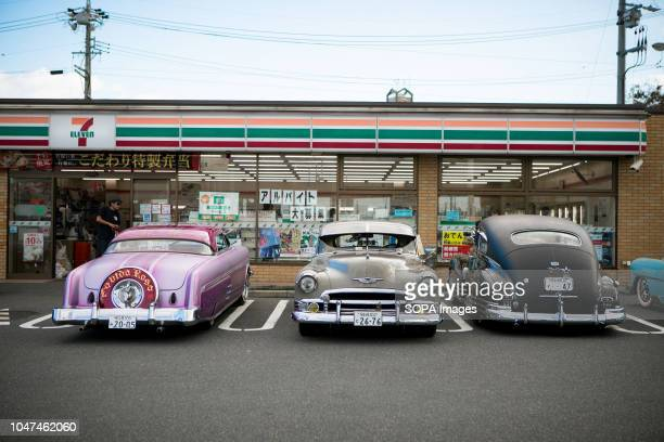 Lowrider cars seen parked outside a seven eleven store in Japan They are customized vehicles belonging to one of Japan's oldest lowrider clubs...