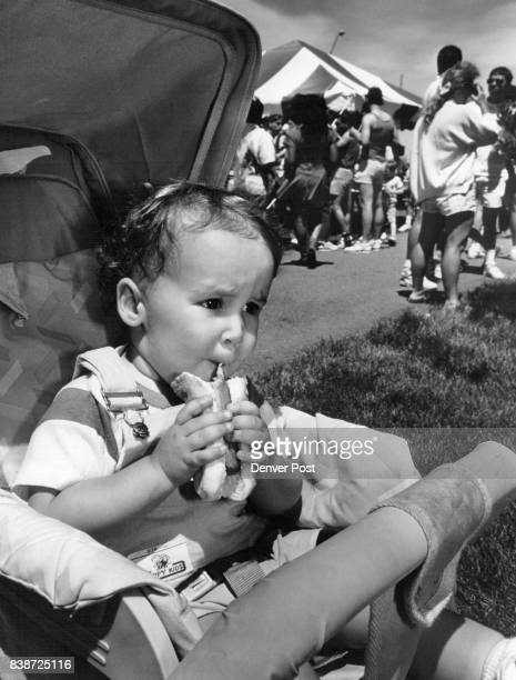 Lowry Base Military appreciation Day Kirk Daley 22 months old eats hotdog His farther is sgt Paul F Daly who is sationed at Lowry Credit The Denver...