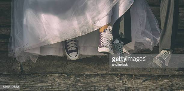 Low-section of newlyweds in canvas shoes