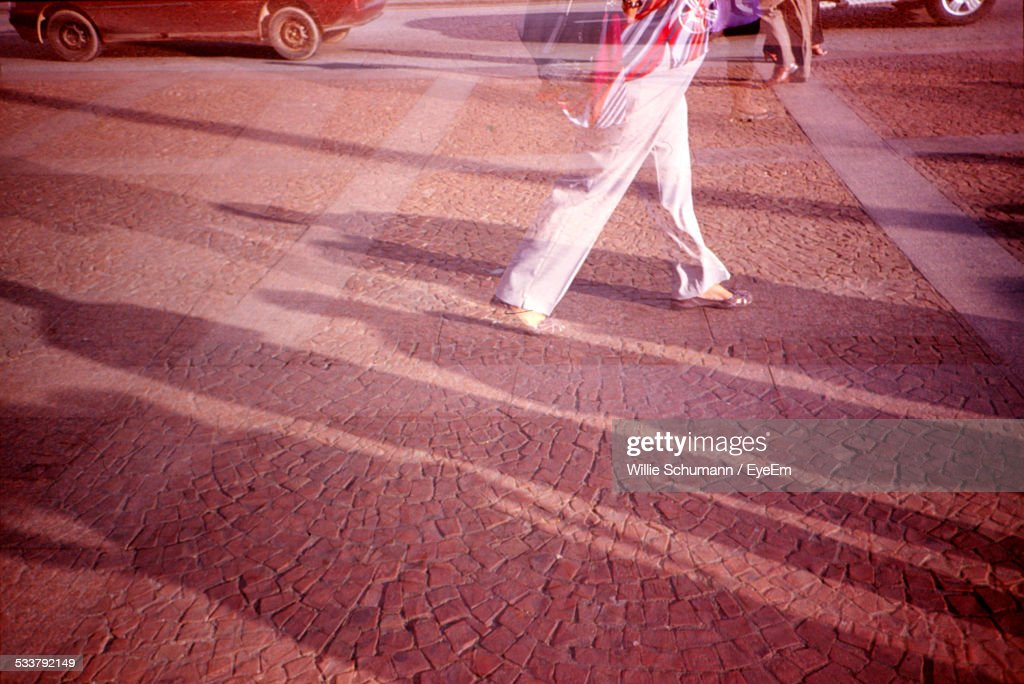 Low-Section Shot Of Woman Walking Across City Square : Foto stock