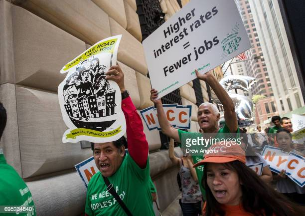 Lowwage workers and their supporters march around the New York Federal Reserve during a rally to call on the US Federal Reserve not to raise interest...