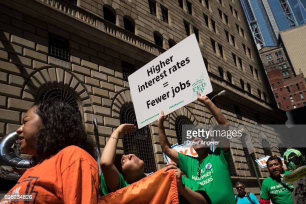 Lowwage workers and their supporters march outside the New York Federal Reserve during a rally to call on the US Federal Reserve not to raise...