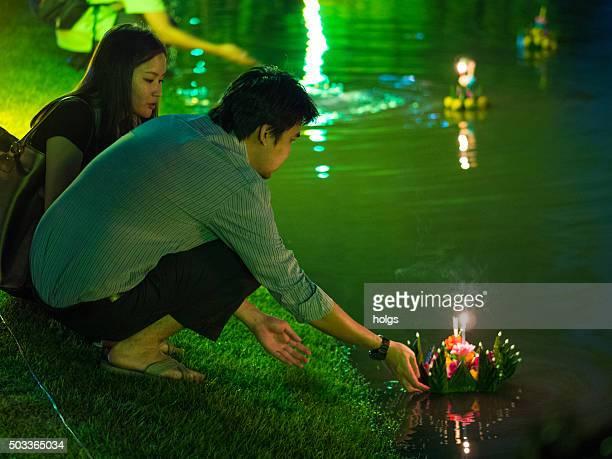loy krathong in lumpini park in bangkok, thailand - loi krathong stock photos and pictures
