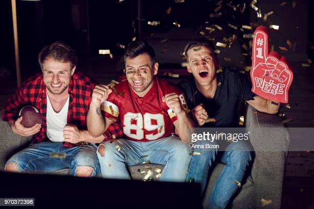 loyal football fans supporting their team. debica, poland - foam finger stock photos and pictures