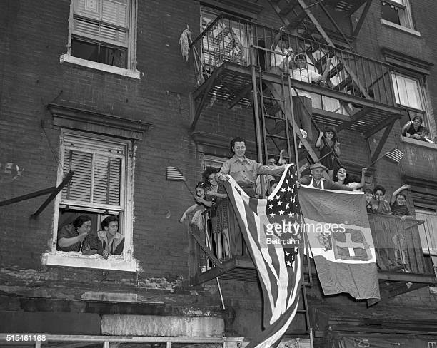 Loyal ItalianAmericans rooting for an allied victory yet proud of their ancestry display the Italian and American flags from a fireescape of a...