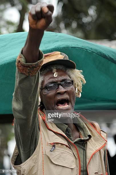 A loyal member of the Ateke Tom militant group raises his fist in support of the government amnesty for the militants in Port Harcourt on October 3...