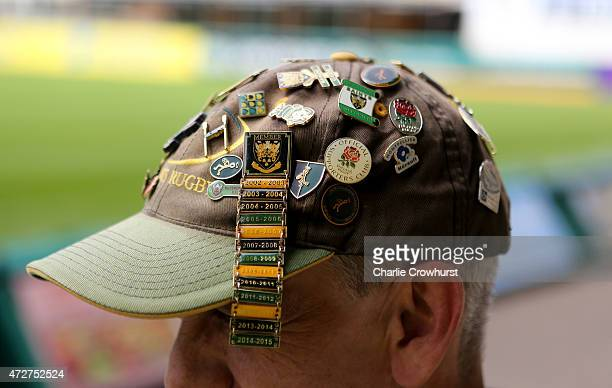A loyal Northampton fans shows off his badge collection during the Aviva Premiership match between Northampton Saints and London Welsh at Franklin's...