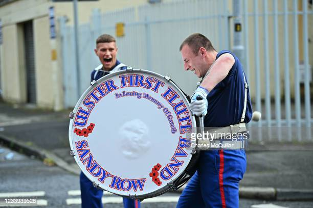 Loyalist band member shouts encouragement at the bands drummer as the annual Twelfth of July march takes place on July 12, 2021 in Belfast, Northern...
