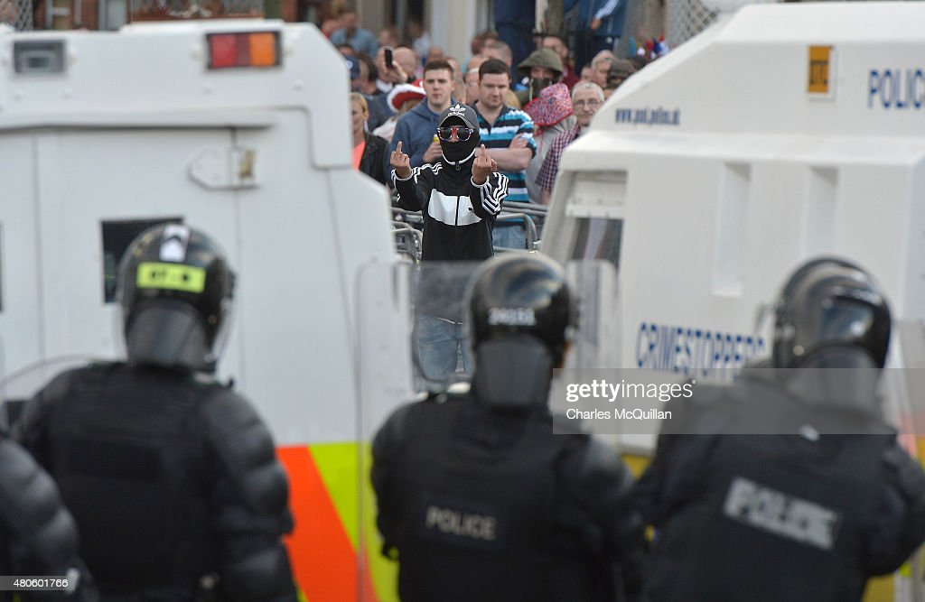A Loyalist breaks through a police barrier and taunts police officers as Orangemen are prevented from progressing on the return journey towards the controversial Ardoyne flashpoint the Twelfth of July parade on July 13, 2015 in Belfast, Northern Ireland. The Twelfth is an Ulster Protestant celebration held annually. It celebrates the victory of Protestant king William of Orange over Catholic king James II at the Battle of the Boyne in 1690, which helped ensure Protestant supremacy in Ireland at that time. This year the Twelfth takes place on the thirteenth of July due to the original date falling on a Sunday.