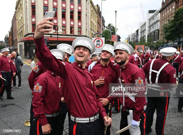 Loyalist flute band members take a selfie as the annual Twelfth of July march takes place on July 12, 2021 in Belfast, Northern Ireland. The Twelfth...