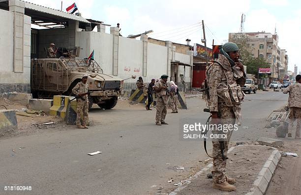 Loyalist forces stand guard outside the central prison in the Mansoura residential district of Yemen's second city of Aden after they retook it and...