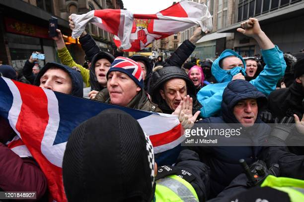 Loyalist supporters demonstrate as a Republican group march through the city to commemorate the anniversary of Bloody Sunday on January 25 2020 in...