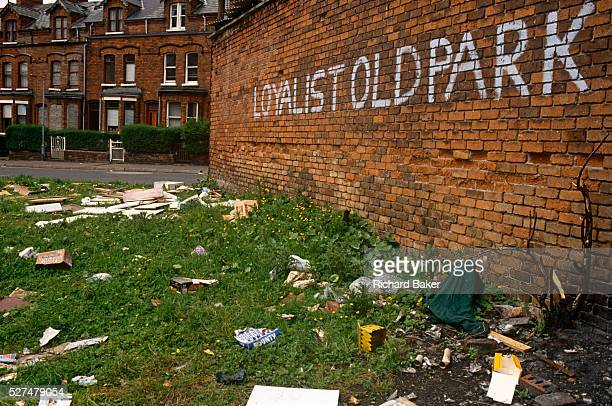 A Loyalist wall and rubbishstrewn wasteground shows the dereliction of 1990s Belfast northern Ireland Rubbish and missing brickwork tell us of a city...