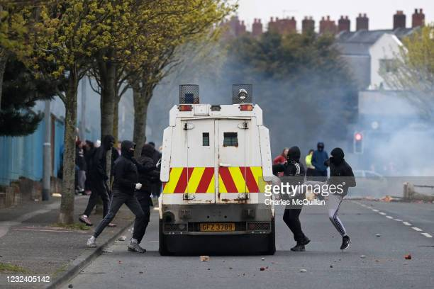 Loyalists attack an armoured police Land Rover on Lanark Way near the 'Peace Gates' interface on April 19, 2021 in Belfast, Northern Ireland....