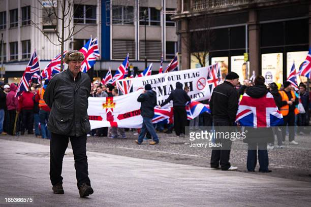 Loyalists block a road with large flags during a protest at City Hall in Belfast, Northern Ireland on January 5, 2013. The demonstrations have taken...