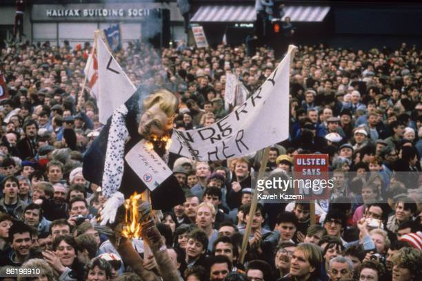 Loyalists burn an effigy of British Prime Minister Margaret Thatcher labelled 'Thatcher Traitor' at a demonstration outside Belfast Town Hall 23rd...