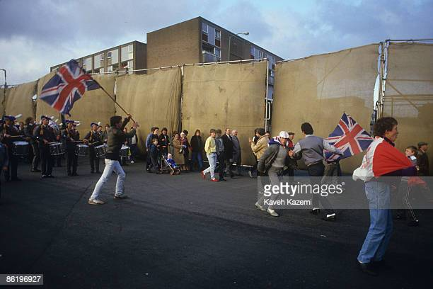 Loyalists march past one of the Peace Lines separating Catholic and Protestant neighbourhoods in Belfast on their way to Belfast Town Hall 23rd...