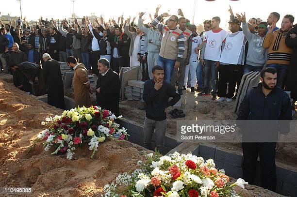 Loyalists of Libyan leader Muammar Gaddafi prepare graves for 24 Libyan servicemen March 20, 2011 in Tripoli, Libya. The bodies did not arrive before...
