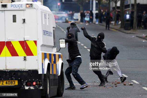 Loyalists throw projectiles at police on Lanark Way near the 'Peace Gates' interface on April 19, 2021 in Belfast, Northern Ireland. Loyalist tension...