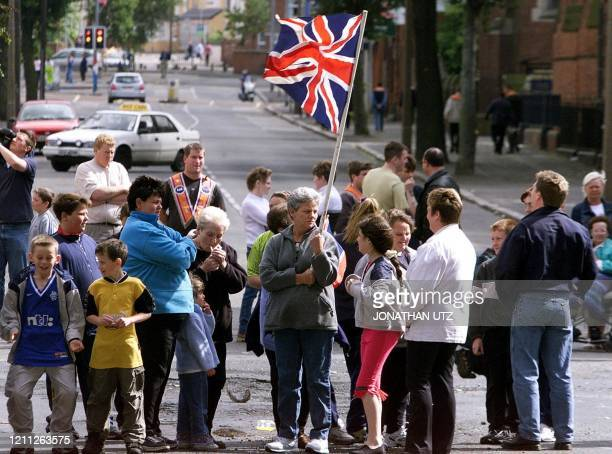 Loyalists waving a British flag close an East Belfast intersection with a demonstration in support of the Drumcree marchers 10 July 2000 The loyalist...