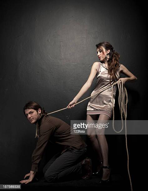 loyalty - women dominating men stock photos and pictures