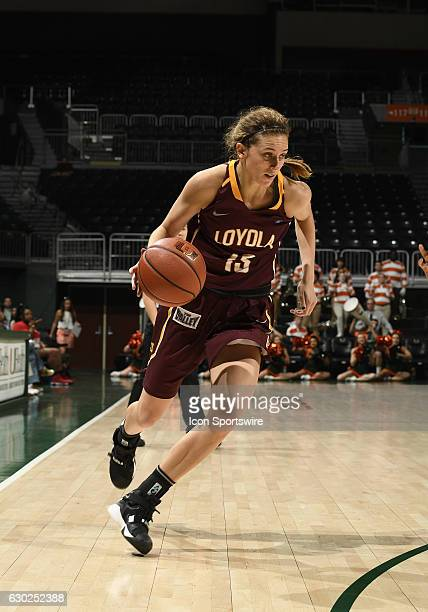 Loyola guard/forward Katie Salmon dribbles during an NCAA basketball game between Loyola Chicago University Ramblers and the University of Miami...