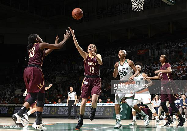 Loyola guard/forward Katie Salmon grabs a rebound during an NCAA basketball game between Loyola Chicago University Ramblers and the University of...