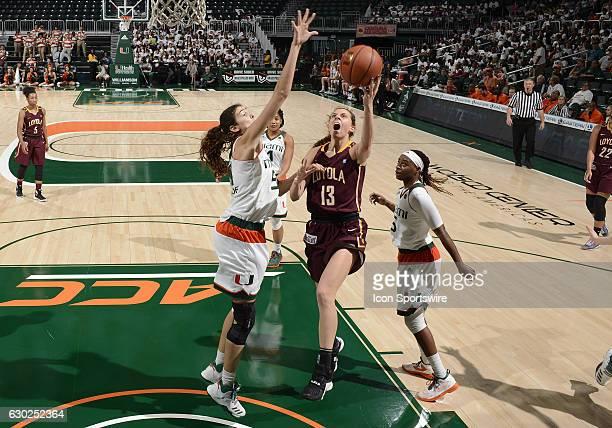 Loyola guard/forward Katie Salmon shoots against Miami center SerenaLynn Geldof during an NCAA basketball game between Loyola Chicago University...