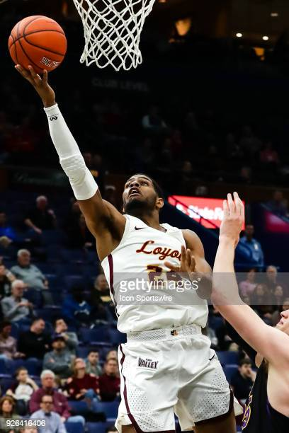 Loyola Ramblers forward Aundre Jackson left goes up for a shot past Northern Iowa Panthers guard Isaiah Brown during the second half of a Missouri...