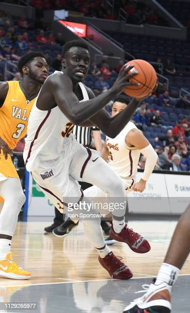 Loyola Ramblers guard Aher Uguak drives the lane to the basket during a Missouri Valley Conference Basketball Tournament game between the Loyola...