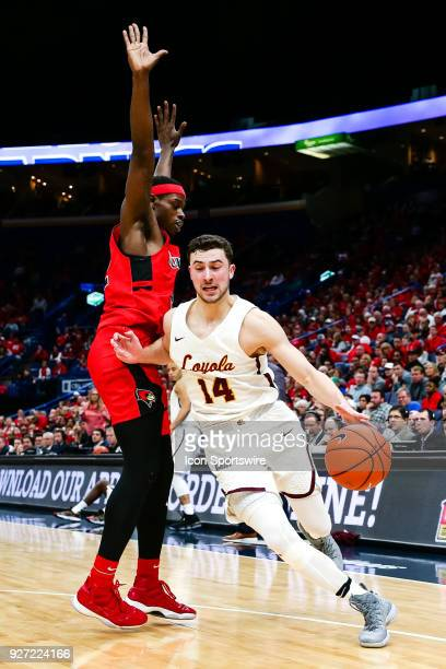 Loyola Ramblers guard Ben Richardson right drives past Illinois State Redbirds forward Milik Yarbrough during the second half of a Missouri Valley...