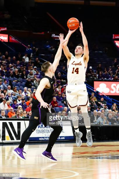 Loyola Ramblers guard Ben Richardson right hits a 3point shot as the shot clock expires over Northern Iowa Panthers forward Klint Carlson during the...