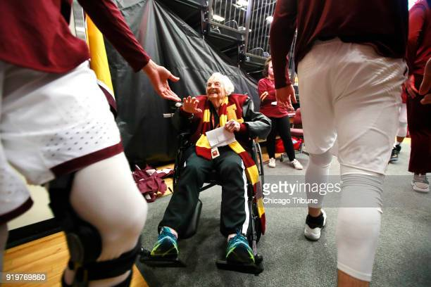 Loyola Ramblers team chaplain Sister Jean Dolores Schmidt high fives Loyola players after a short prayer with them before the start of a game against...