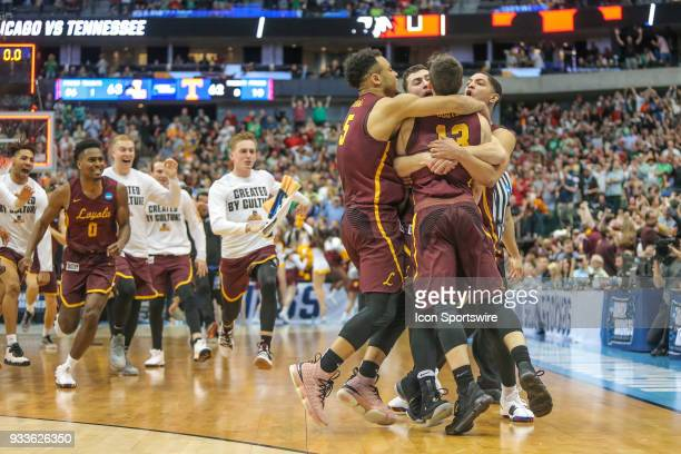 LoyolaChicago Ramblers players celebrate winning the NCAA Div I Men's Championship Second Round basketball game between LoyolaChicago and Tennessee...
