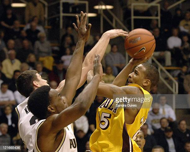 Loyola's JR Blount tries to shoot in heavy opposition in a game won by Purdue 78-62 over Loyola-Chicago in Mackey Arena, West Lafayette, IN Dec. 5,...
