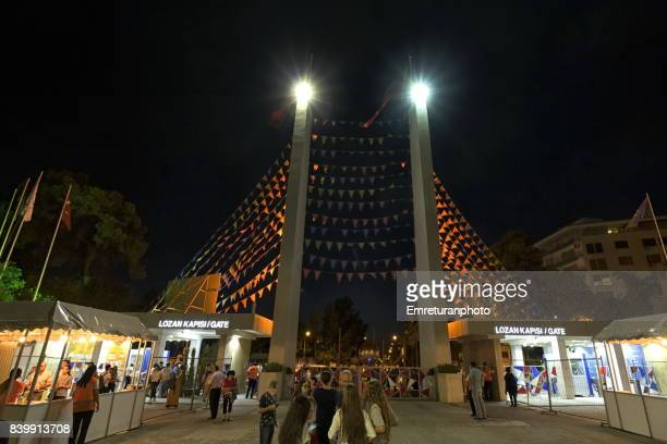 lozan gate of international fair of izmir at night. - emreturanphoto stock pictures, royalty-free photos & images