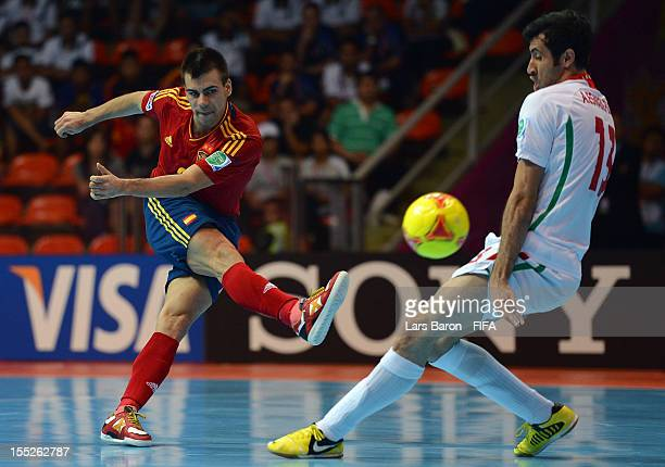 Lozano of Spain is blocked by Ahmad Esmaeilpour of Iran during the FIFA Futsal World Cup Group B match between Spain and Iran at Indoor Stadium...