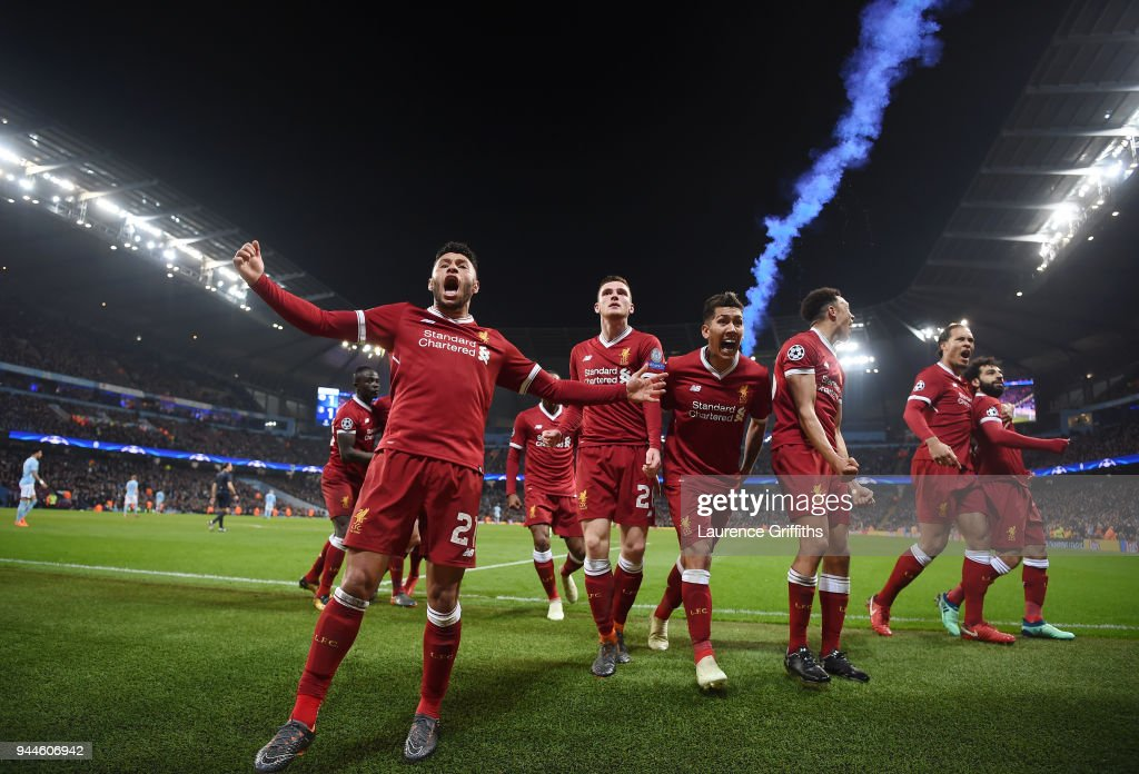 l-r Alex Oxlade-Chamberlain, Andy Robertson, Roberto Firmino, Trent Alexander-Arnold, Virgil Van Dijk and goal scorer, Mohamed Salah of Liverpool celebrate the their first goal during the Quarter Final Second Leg match between Manchester City and Liverpool at Etihad Stadium on April 10, 2018 in Manchester, England.