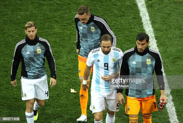 lr Cristian Ansaldi Franco Armani Gonzalo Higuain and Nahuel Guzman of Argentina walk off after the 2018 FIFA World Cup Russia group D match between...