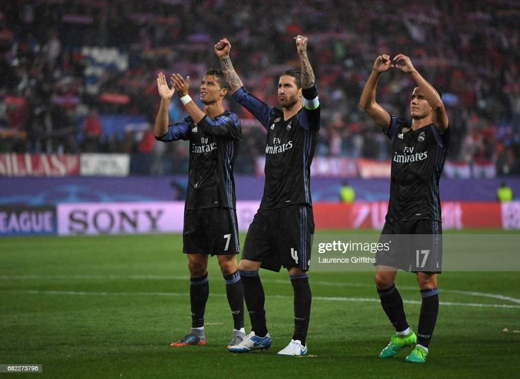 l-r Cristiano Ronaldo, Sergio Ramos and Lucas Vazquez of Real Madrid celebrate at the end of the UEFA Champions League Semi Final second leg match between Club Atletico de Madrid and Real Madrid CF at Vicente Calderon Stadium on May 10, 2017 in Madrid, Spain.