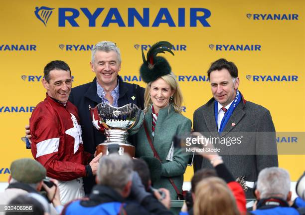 lr Davy Russell Michael O'Leary Anita Farrell and Trainer Henry De Bromhead clebrate the victory of Balko Des Flos in the Ryanair Chase at Cheltenham...