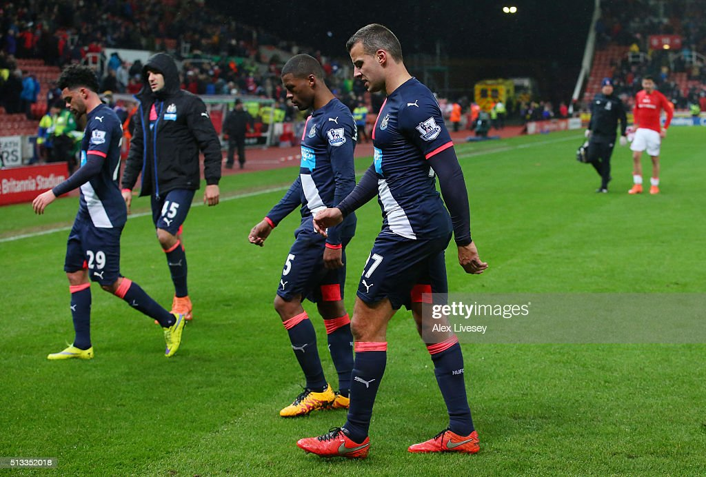 l-r Emmanuel Riviere, Aleksandar Mitrovic, Georginio Wijnaldum and Steven Taylor of Newcastle United walk off dejected after the Barclays Premier League match between Stoke City and Newcastle United at the Britannia Stadium on March 2, 2016 in Stoke on Trent, England.