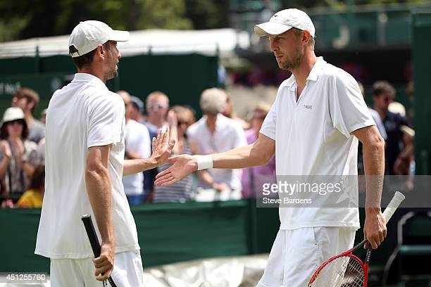 lr Igor Zelenay of Slovakia and Andreas Siljestrom of Sweden during their Gentlemen's Doubles first round match against JohnPatrick Smith of...