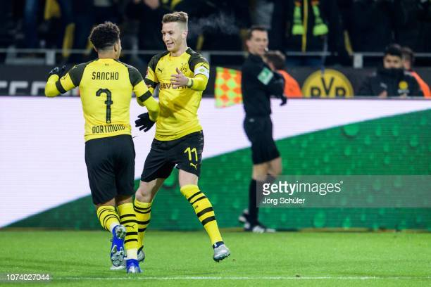 lr Jadon Sancho and Marco Reus of Dortmund react after the 20 lead during the Bundesliga match between Borussia Dortmund and SV Werder Bremen at the...