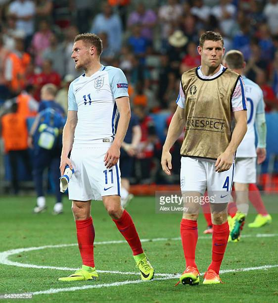 lr Jamie Vardy and James Milner of England shows their dejection after the 12 defeat in the UEFA EURO 2016 round of 16 match between England and...